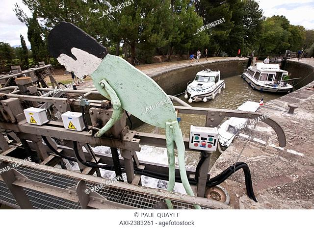 Cruise boats at the Aiguille lock on the popular Canal du Midi; France