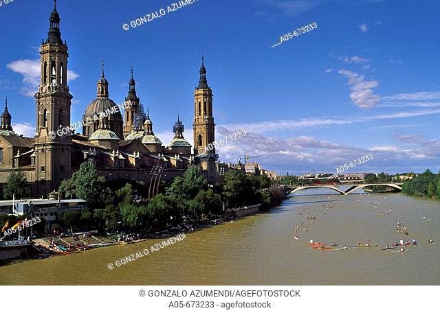 Canoe competition. Nuestra Señora del Pilar festival. El Pilar basilica and Ebro river. Zaragoza. Aragon, Spain