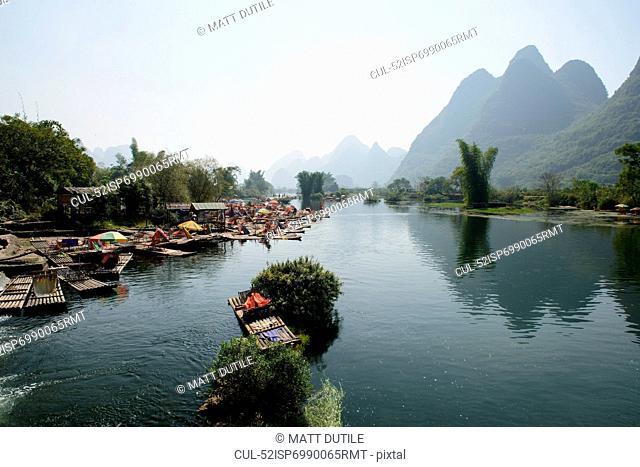 Boats docked in still rural lake