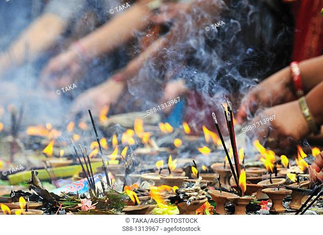 Candle flame and smoke of incense at Chyasin Dega temple in Hanuman Dhoka Durbar