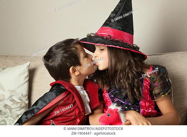 Children kissing on Halloween party