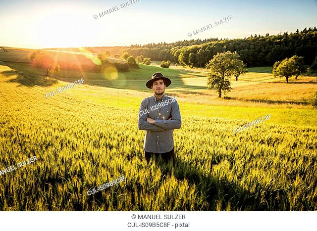 Portrait of mid adult man, standing in field, Neulingen, Baden-W³rttemberg, Germany