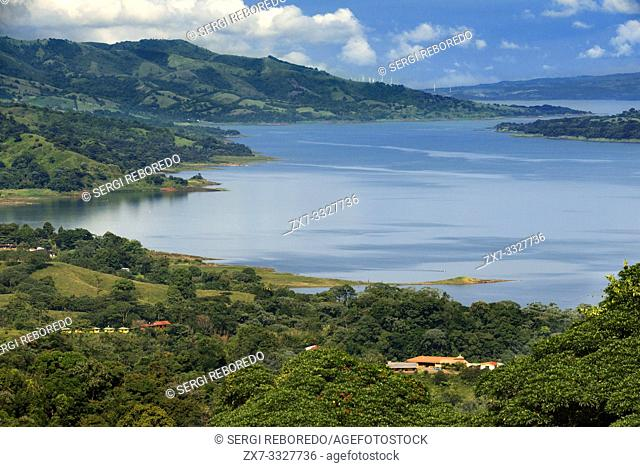 Arenal lagoon in Arenal Costa Rica Central America. Volcanic lagoon Arenal surrounded by lush tropical vegetation, Costa Rica