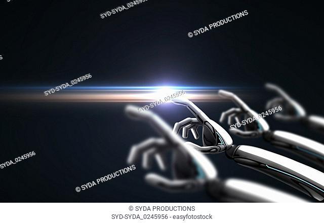 robot hands over black background and laser light
