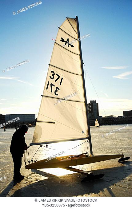 An adult man brings his ice yacht back to the marina in Red Bank, New Jersey