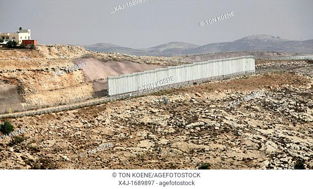 Israel is building a wall around the west bank territories, blocking access for Palestinians who feel imprisoned by it