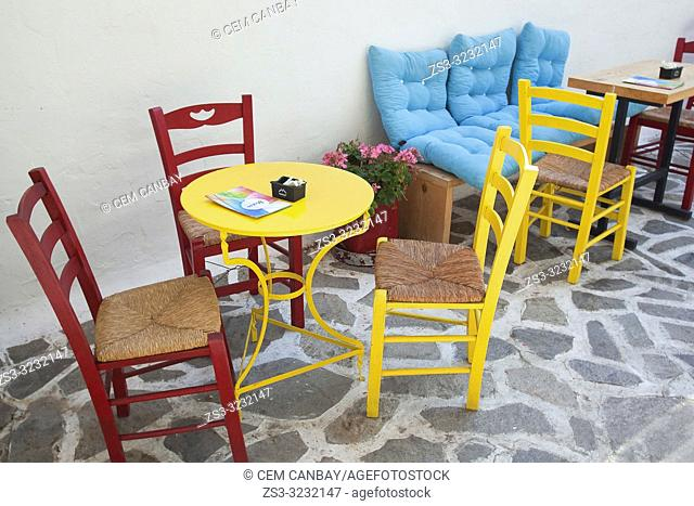 Traditional chairs and table in the alleys of the old town Chora, Naxos Island, Cyclades Islands, Greek Islands, Greece, Europe
