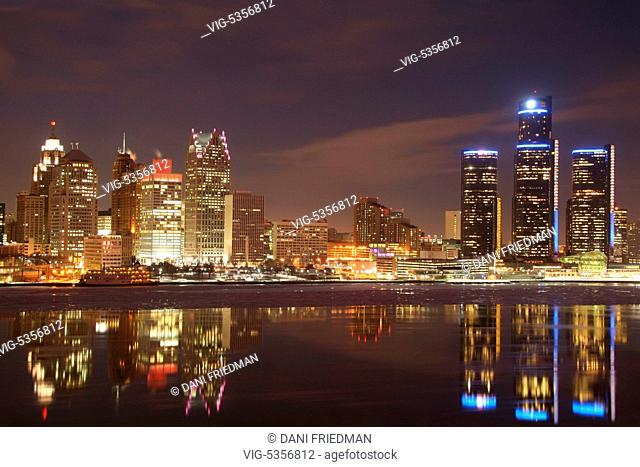 Skyline of downtown Detroit, Michigan, USA illuminated at night. Ice can be seen floating in the Detroit River. Detroit is known as The Motor City, The D