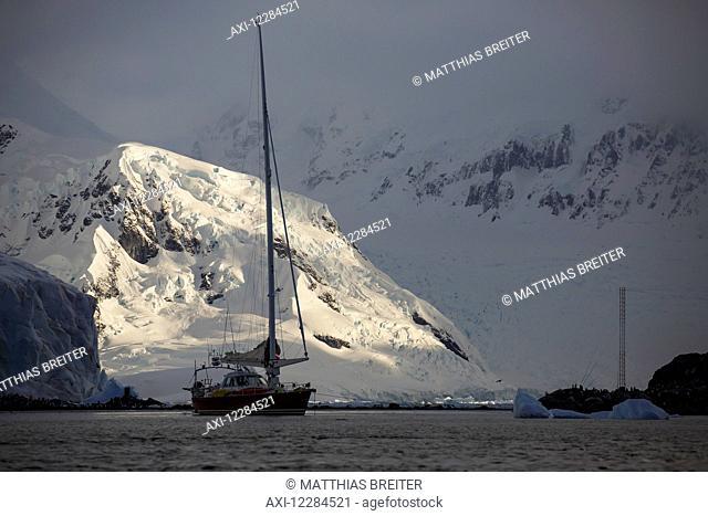 Sailboat at Yelcho/Videla Base (Chile) in Paradise Harbour, Antarctic Peninsula; Antarctica