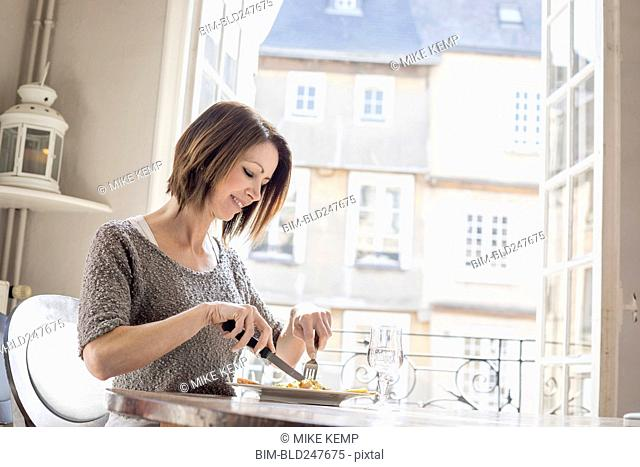 Caucasian woman eating a meal