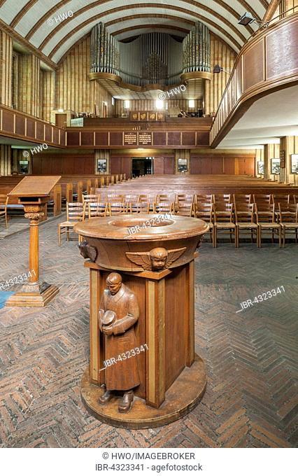 Wooden baptismal font decorated with carvings of a SA man in a storm-troopers' uniform, Martin Luther Memorial Church, 1933 to 1935, Interior, Berlin