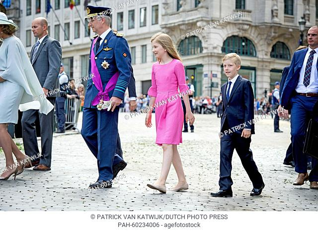 King Philippe of Belgium (center L), Crown Princess Elisabeth and Prince Emmanuel after the Te Deum mass at the Cathedral of St. Michael and St
