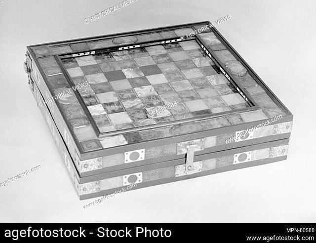 Chess and backgammon board. Date: 17th-18th century; Culture: possibly German, Königsberg; Medium: Amber, ivory, brass, ebony; Dimensions: closed