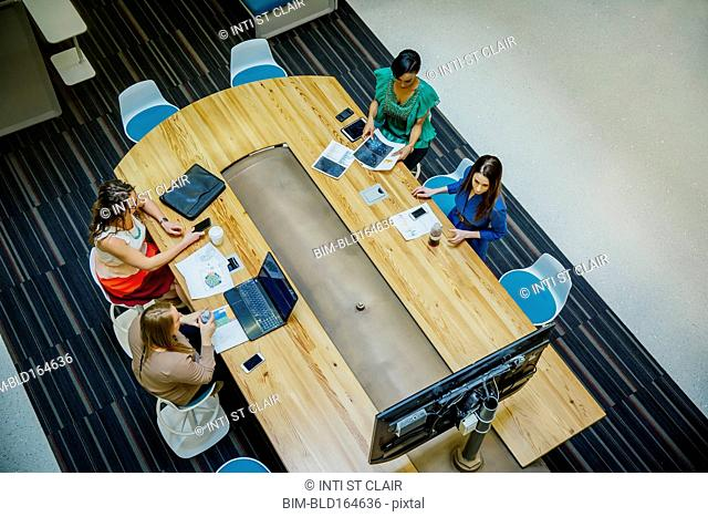 High angle view of businesswomen working in office meeting