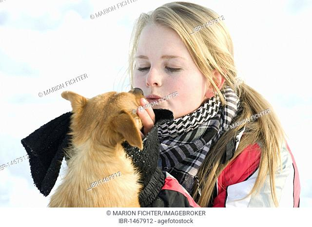 Girl, teenager with a small dog, winter