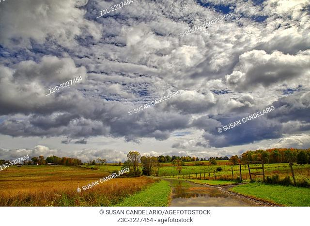 Rural New Paltz Hudson Valley, NY - Landscape view with a dramatic sky after a passing storm with the bright colors of peak fall foliage.