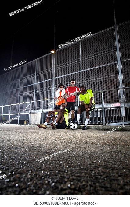 street football players relaxing after match