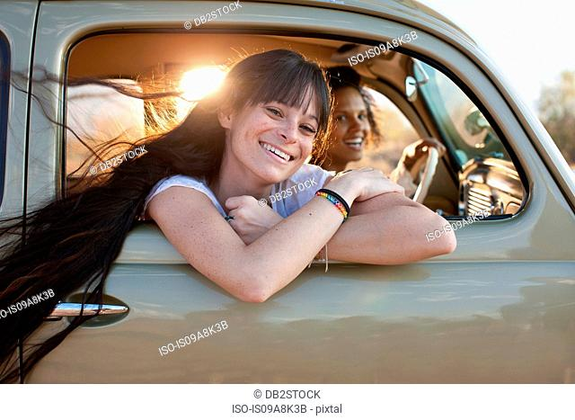 Young women travelling in car on road trip, portrait