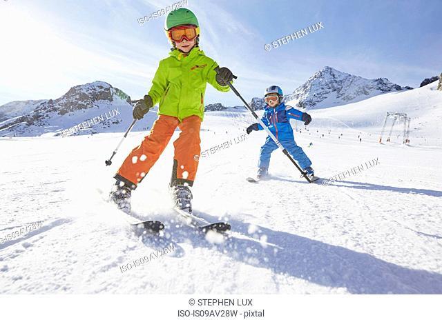 Boys skiing, Stubai, Tyrol, Austria