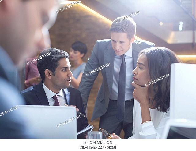 Serious business people talking in office