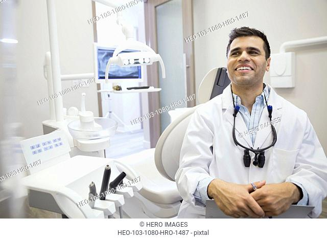Dentist laughing in office