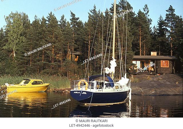 Boats by summer cottage shore  Dragsfjard, Finland