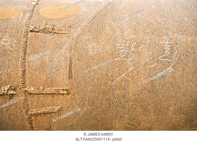 Metal surface with Chinese characters handwritten in chalk