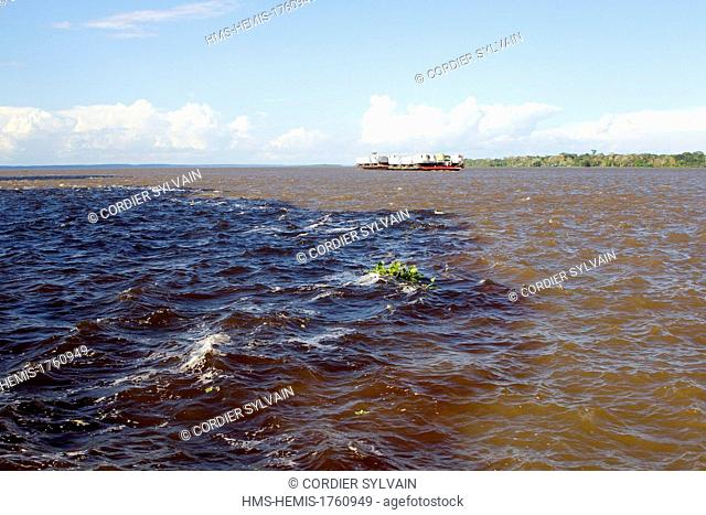 Brazil, Amazonas State, Amazon River, phenomenon of the meeting of waters, the black waters of the Rio Negro meet the white waters of the Rio Solimoes