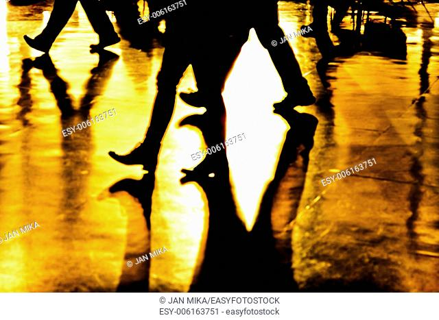 Abstract, creative, digitally altered and toned photo of people legs and their shadows