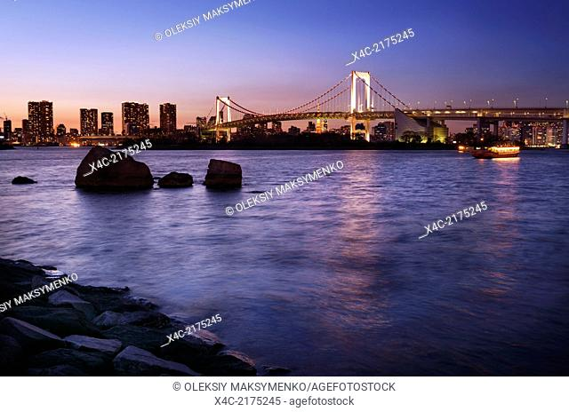 Colorful twilight scenery of the Rainbow bridge across Tokyo Bay at dusk. Odaiba, Tokyo, Japan