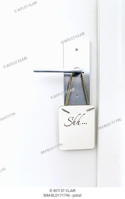 Do not disturb sign on hotel room doorknob
