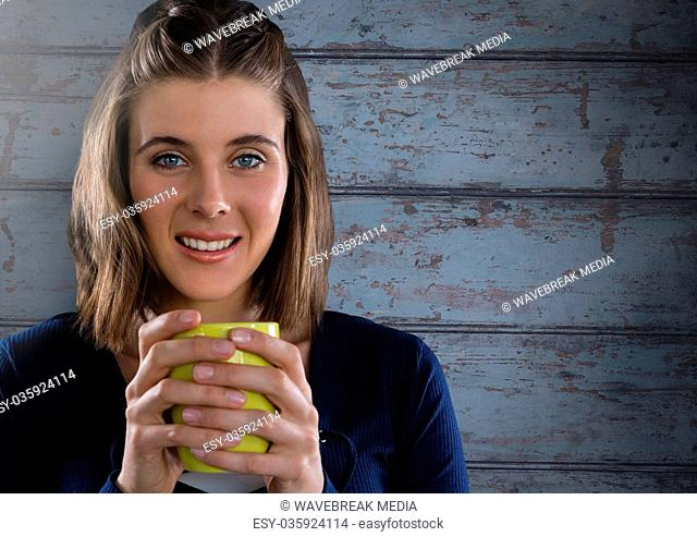 Woman against wood with cup