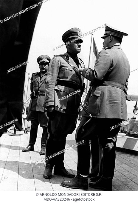 Galeazzo Ciano with two officers on the deck of the Spanish cruiser Almirante Cervera. The Italian Foreign Minister Galeazzo Ciano talks with two of his...