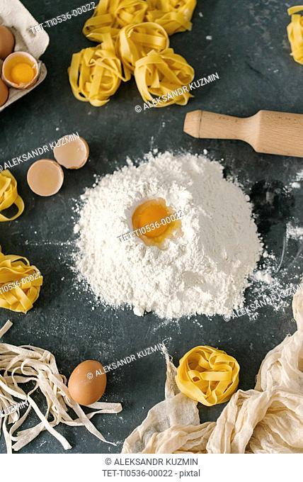 Egg on mound of flour