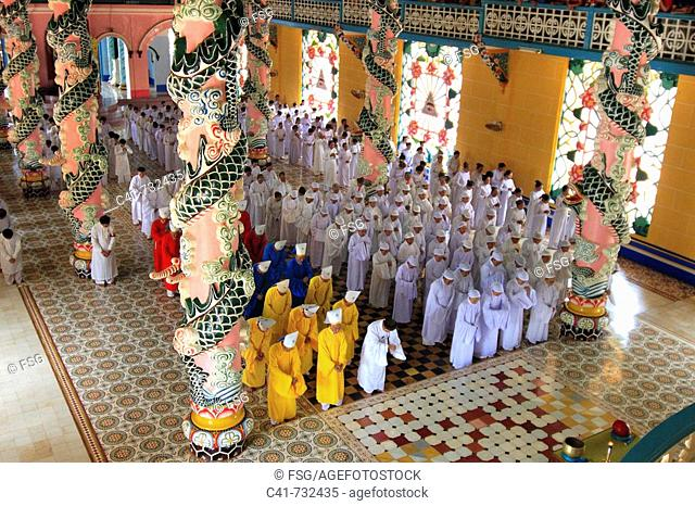 Ceremony in Cao Dai temple, Tay Ninh, Vietnam