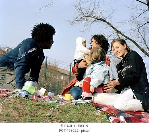 Friends and family having a picnic in a park