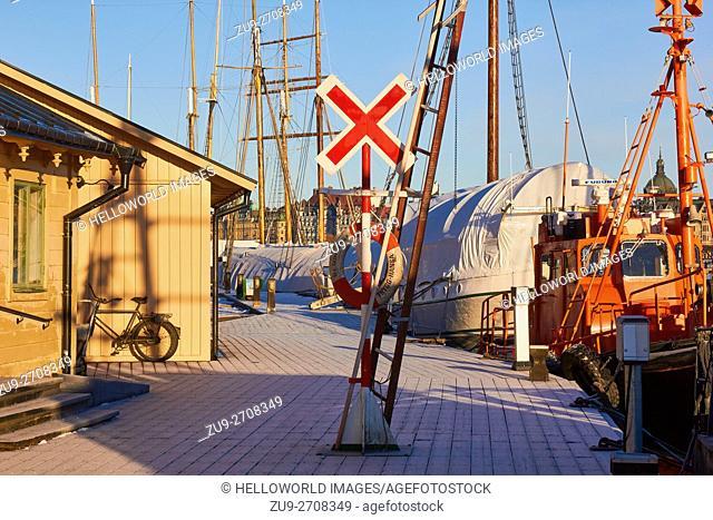 Boats and trawlers moored in winter on Skeppsholmen Island, Stockholm, Seeden, Scandinavia