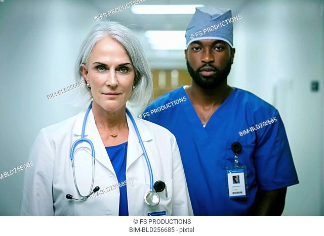 Portrait of serious doctor and nurse