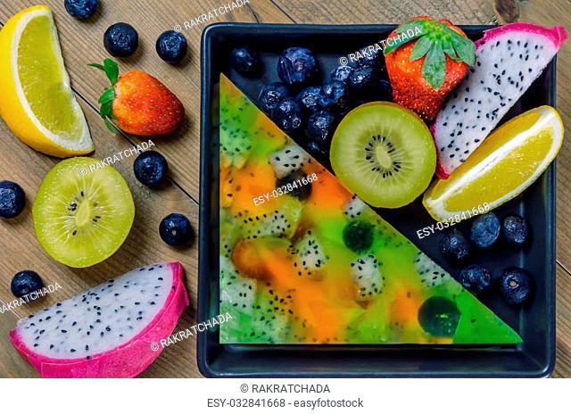 Top view of mixed jelly fruits ( strawberry, blueberry, kiwi, orange, dragon fruit )