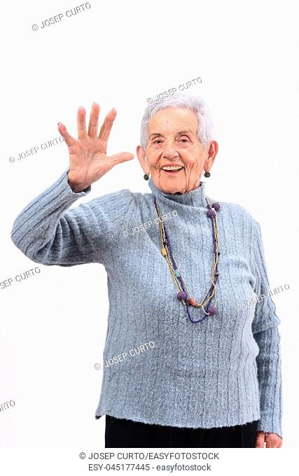 senior woman with open hand and number five on white background
