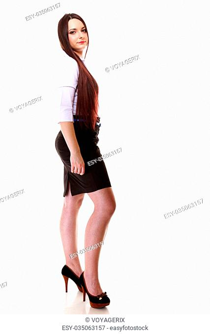Full length young woman straight long dark hair make up posing in studio isolated on white background