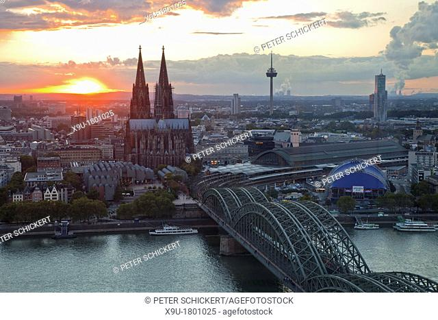 Cityscape Cologne at sunset with Cologne Cathedral, Rhine River, Musical Dome and Hohenzollern Bridge, Cologne, North Rhine-Westphalia, Germany, Europe