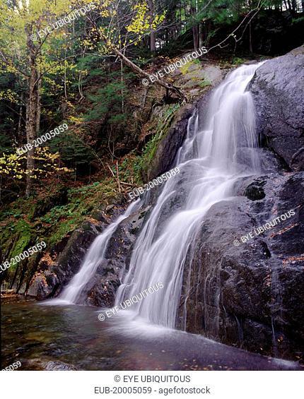 Moss Glen Falls. Waterfall over steep rockface in wooded area