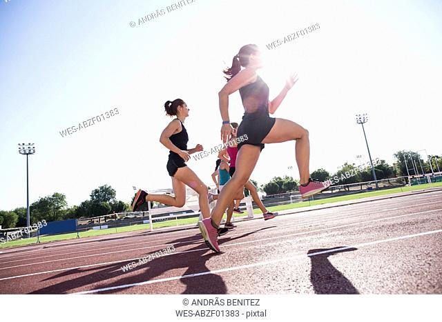 Female runners on tartan track