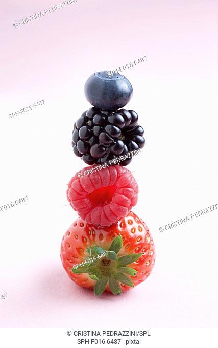 Fresh berries in a stack, studio shot