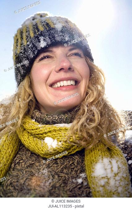 Woman in woolly hat, smiling