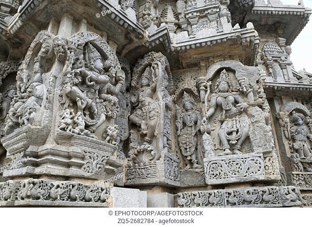 Ornate wall panel reliefs depicting (From left) dancing Shiva, Krishna as Kaliya-mardana and a deity and dancing Parvati, Kedareshwara temple, Halebidu