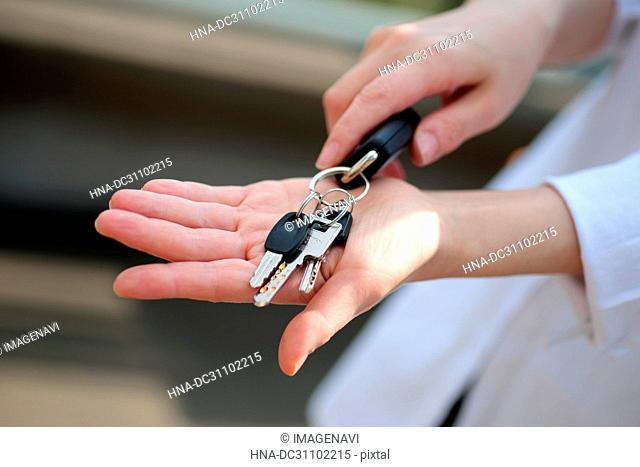 Woman Hand Holding Key