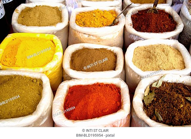 Variety of colorful Indian spices in sacks