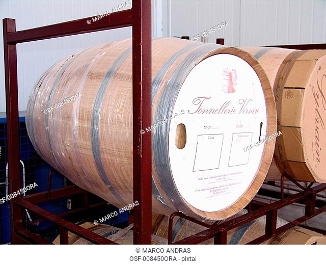wine barrels with wine alcoholic drink